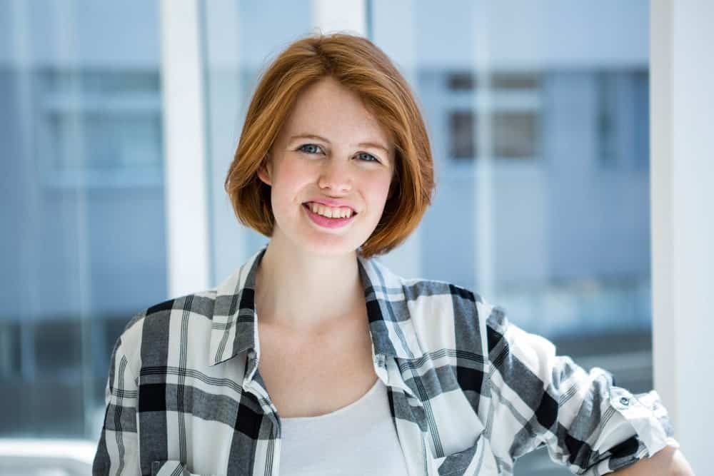 A clean, sleek bob looks very professional. The auburn color gives the bob some color to make it look cute and classic.