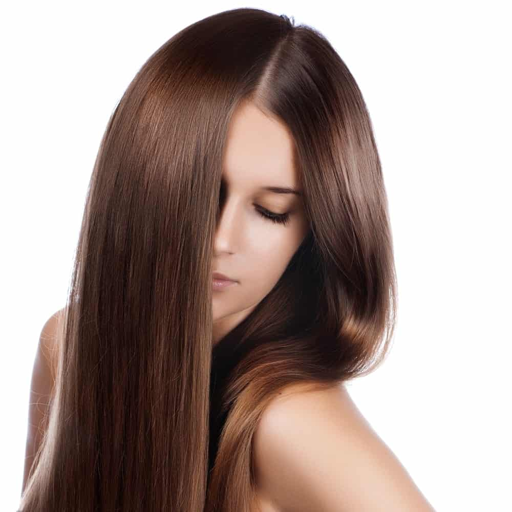 For all those people who prefer to do something very basic and low-key with their hair, this style is going to suit them the best. It is a very simple straight hairstyle with a middle parting and half the face covered with hair on both sides of the face.