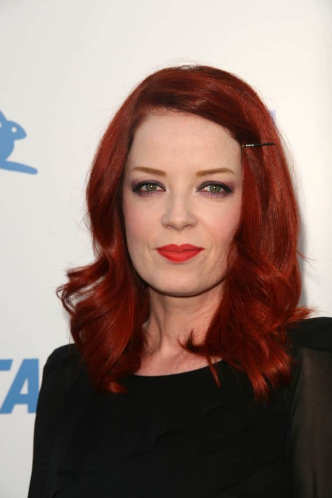 Who knew a single clip could add so much character to a hairstyle? Shirley Manson looks absolutely stunning with her hair simply pulled off to the side and curled at the bottom for a pleasant, easy going effect.