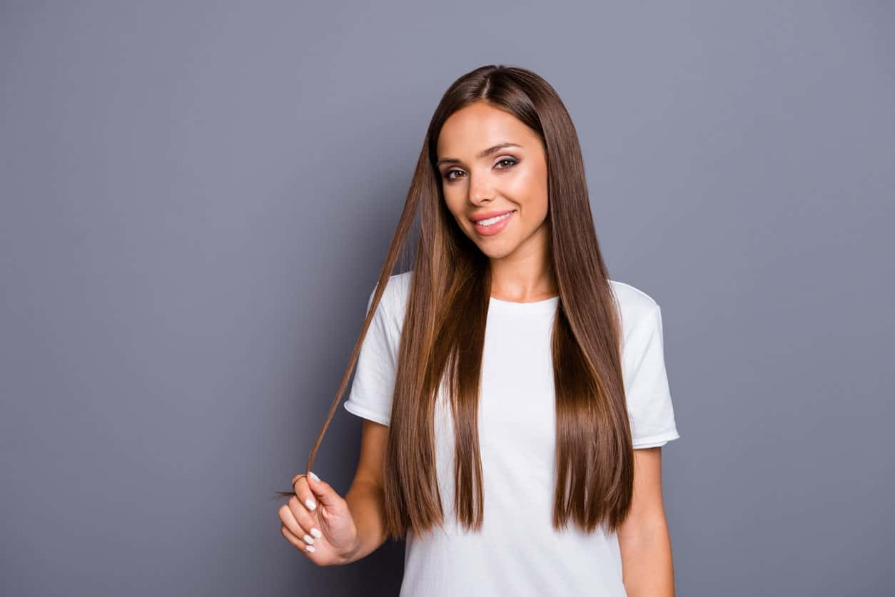 Parting your hair at the center and wearing it down on both sides is without a doubt the easiest hairstyle to sport regardless of the length. It may not be the first choice for many but it is still the go-to hairstyle for women with long hair who are running late for an appointment.