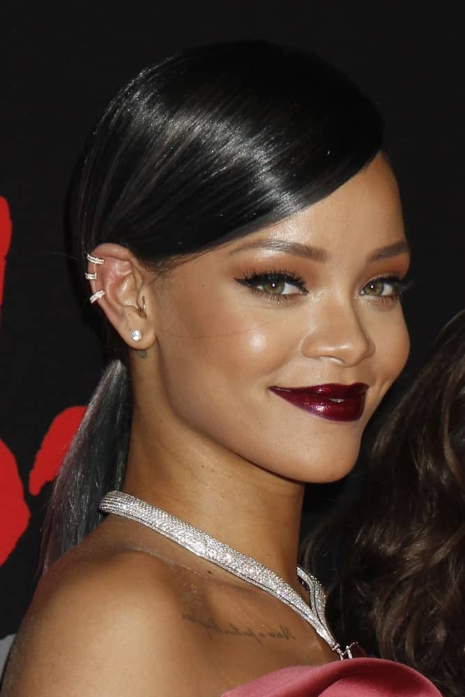 This iconic look by Rihanna is loved by many. The hair is slicked to one side so that it looks sleek and shiny. The rest of the hair is pulled into a straight pony which looks super elegant.