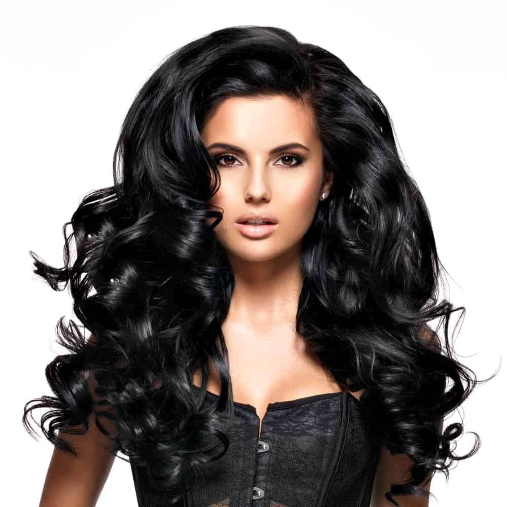 These are the ultimate voluminous curls with a huge poof in the front followed by both loose and tight curls here and there. This hairstyle provides depth to your over all look.