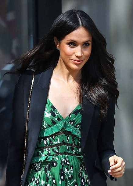 Talking about beautiful long hairstyles for women, let's not forget the charming Meghan Markle. The Hollywood star-turned-royalty always lets her dark black-brunette hair shine. Sporting super side-swept layers most of the time, she proves that a deep side or center-parted look always goes great on women with long hair.