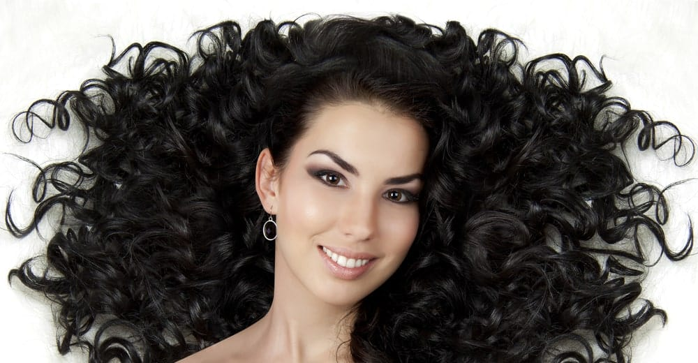 This hairstyle is best described as dramatic with spring-like curls that go all over the place making it look super voluminous.