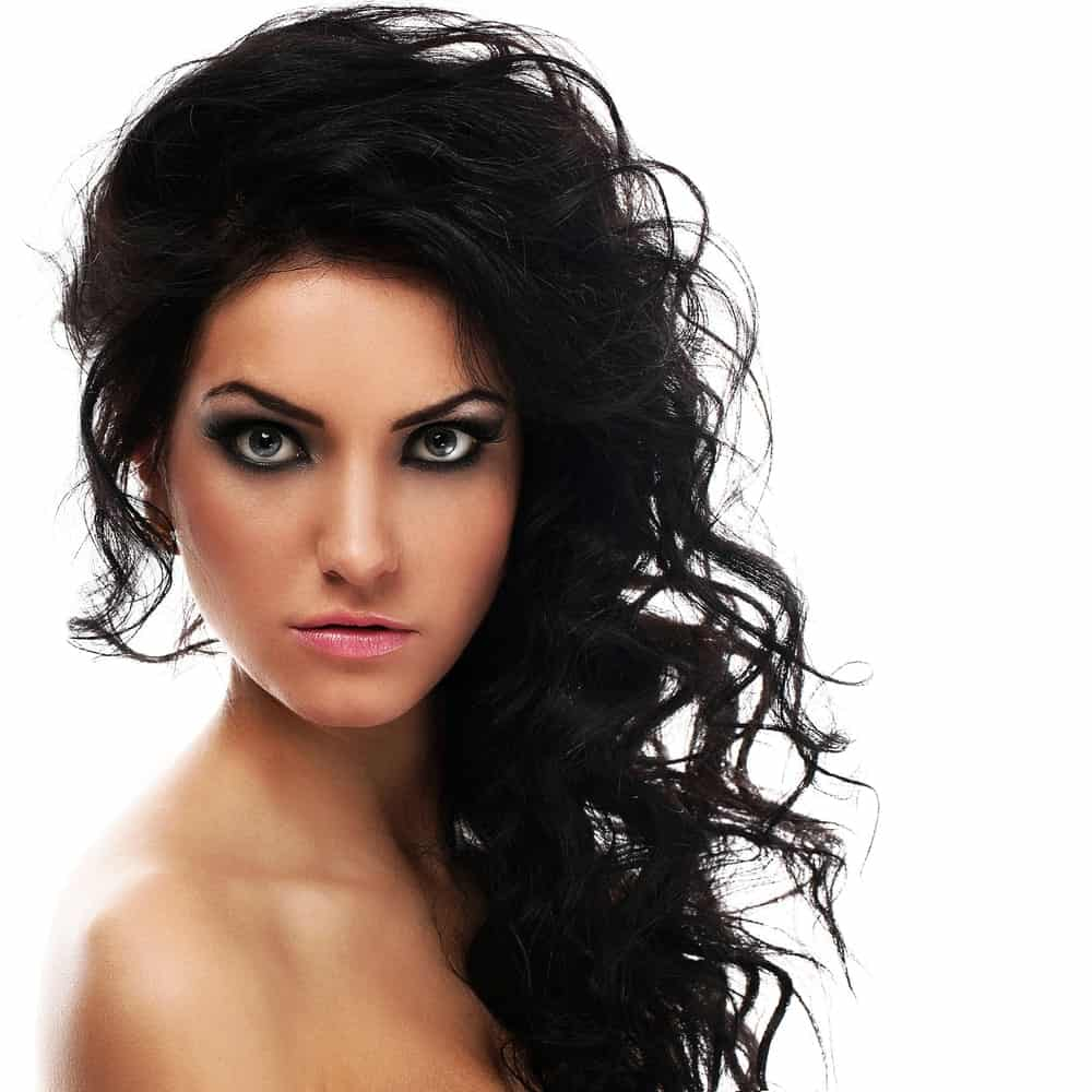 These are towering-like curls with all the hair from one side swept to the other side and has small loose curls.