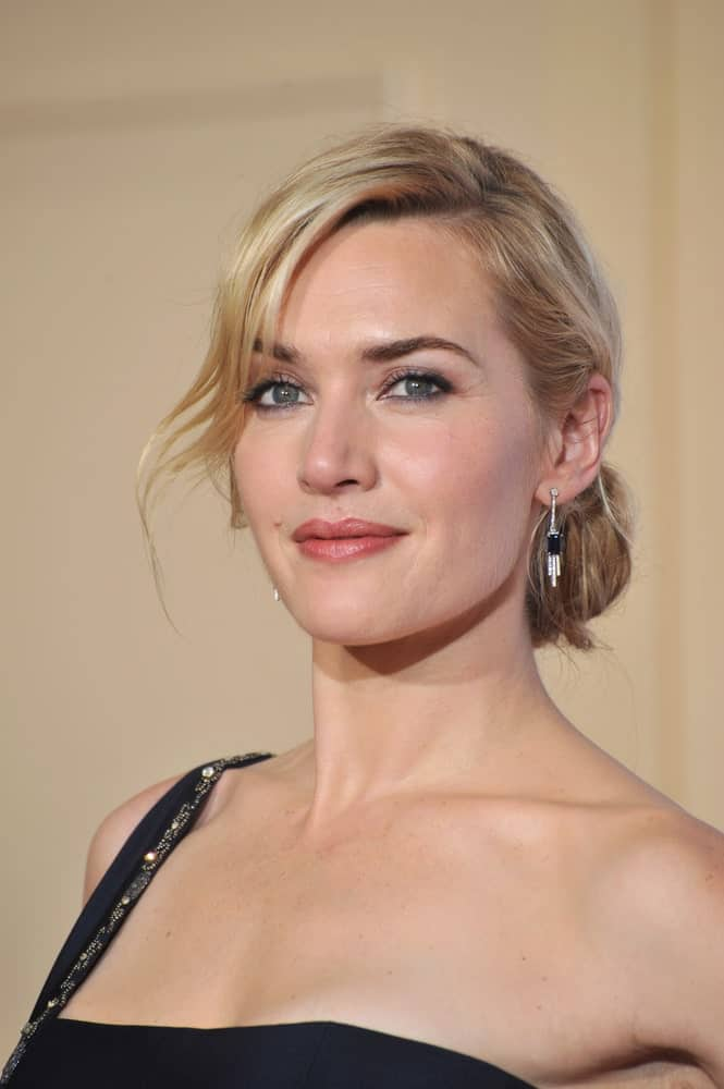 This side-swept bangs hairstyle sported by Kate Winslet shows how wavy bangs and a neat bun look glamorous and elegant.