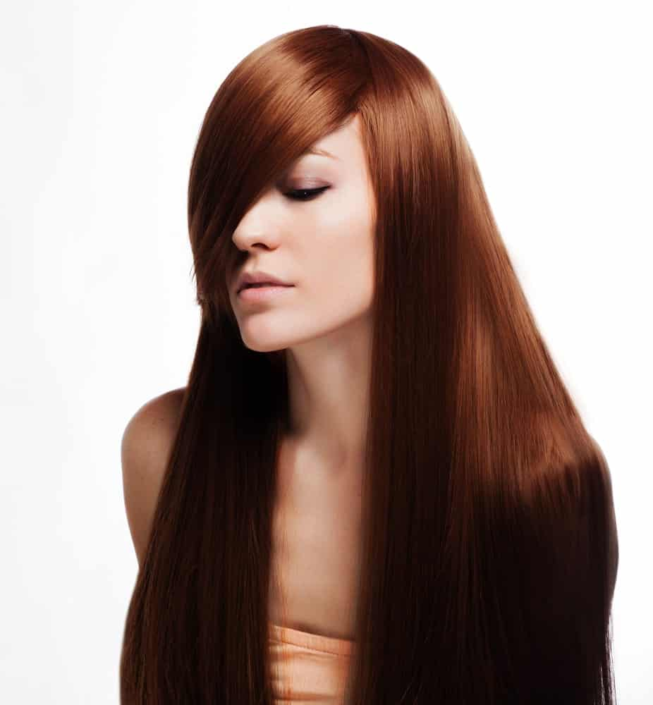 This is a beautiful hairstyle with a side parting that has been extended more than usual from the left side, in a way that the hair covers more than half the face from the other side.