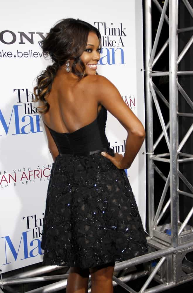 If you are not fond of letting your hair down, perhaps style it like Gabrielle Union with half the curls piled on top of the head and some stands falling loose at the back.