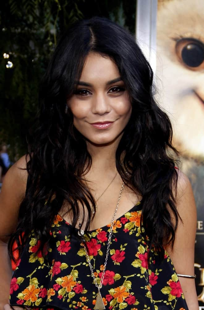 Vanessa Hudgens styles her long hair all let down and fashioned into slight and subtle curls.
