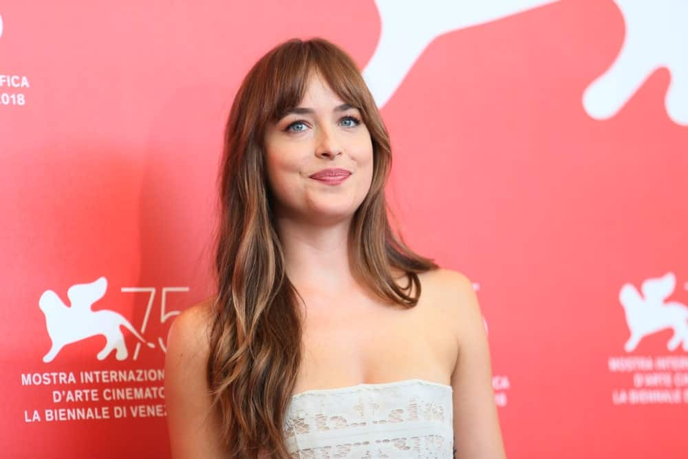 "The ""Fifty Shades of Grey"" actress has almost always sported bangs with her beautiful brunette hair. Here, Dakota Johnson parted her fringe in the middle to create a curtain effect. She then let her long hair flow down casually on one shoulder, in a messy waterfall."