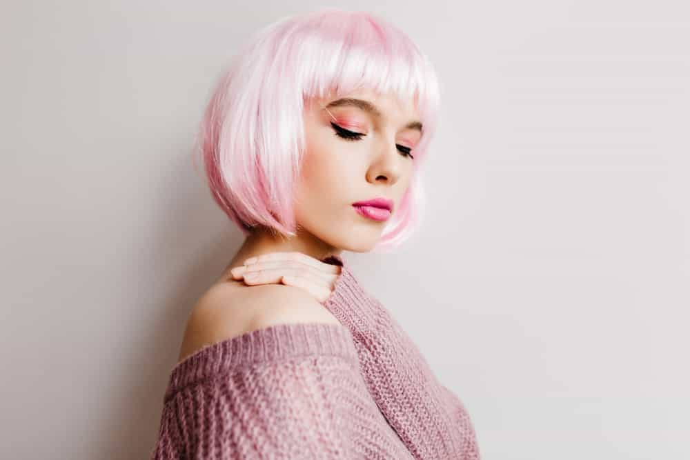 From whistleblower Christopher Wylie to socialite Khloe Kardashian, a lot of people have turned to rocking pink hair, alongside the silver locks. You can give your hair a two-toned look by blending pink and white tones for a whimsical look or graduate your natural locks to a pink color. The choice is yours.