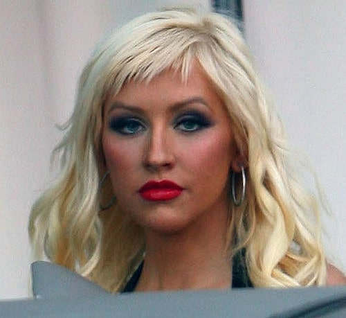 The spiky blond short bangs are the perfect complementary haircut to the wavy hair that Christina Aguilera has. They make her forehead look smaller and give her intense, smoky makeup the perfect boost.