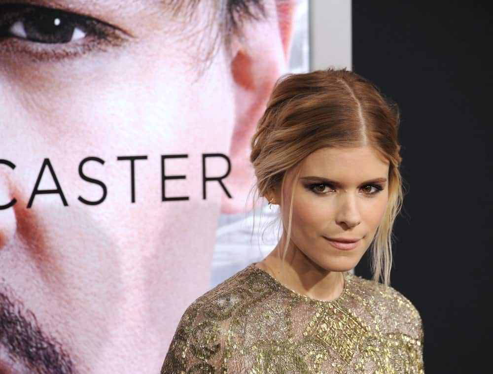 "Kate Mara shows how you can make a chignon classy and messy. ""The Martian"" actress kept her roots dark but opted to add caramel brown to pale blonde colors in her ombre. She parted her hair in the middle to pull it back in a chignon and pulled several strands loose from her bun to frame her face. The result was an edgy yet chic look."
