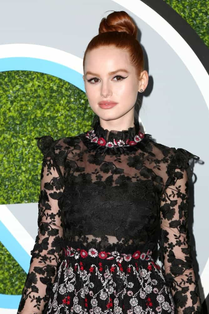 Keeping it classy once again, Madelaine Petsch sports a sleek, tight knot that looks like a fiery burst of color on top of her head.