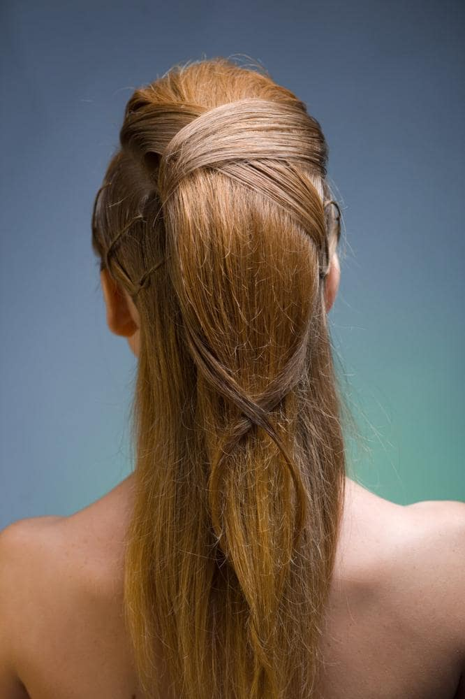 This hairstyle for women with long hair is not only easy to make but it also lets your hair shine, making it look glamorous. All you need to do is make a double-decker ponytail and wrap a few strands around the upper one.