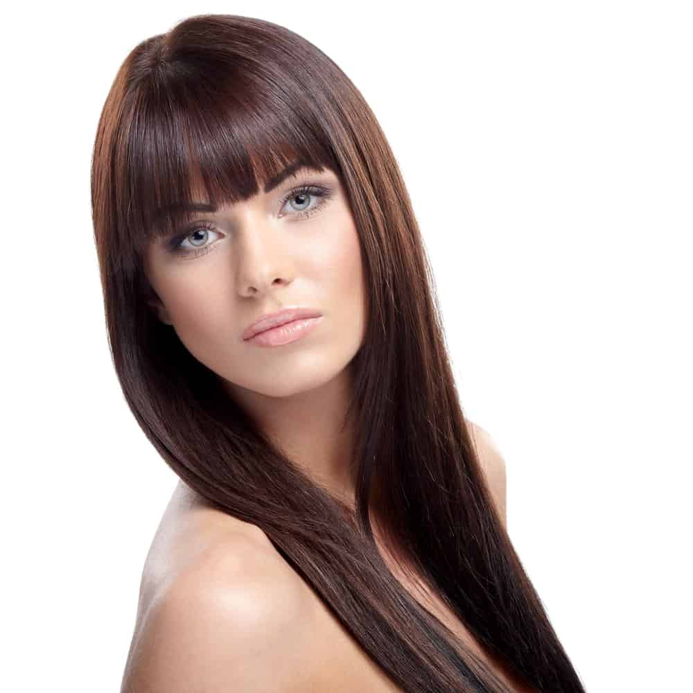 This is another classic hairstyle with super straight and sleek hair that has been gathered together on both sides. It also has very neatly cut straight fringes in the front, making it look really cute and funky.