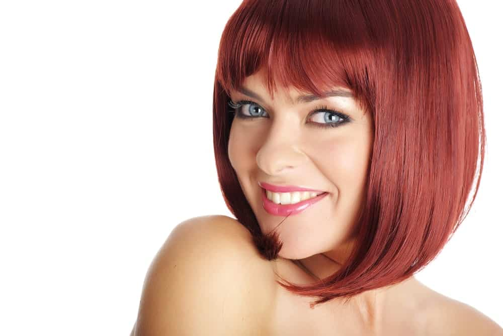 A short, angled bob with short fringes can never look bad on any hair color. It's great if you have a smaller face and large forehead as it can perfectly accentuate your angles!