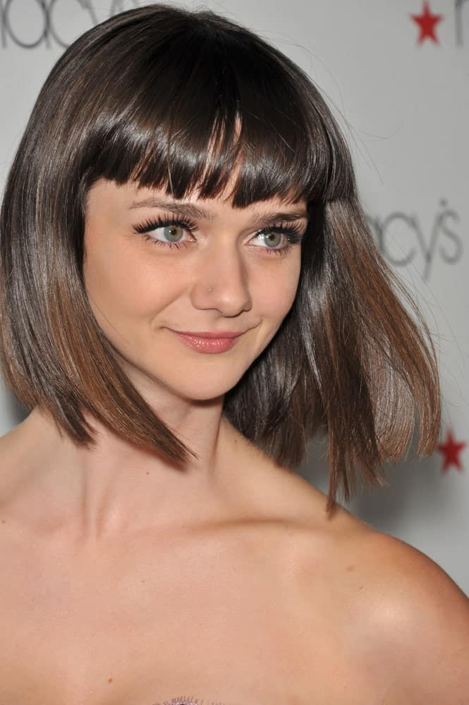 While everyone's going crazy over Taylor Swift's blunt bangs look, characterized by slightly shorter bangs, this hairstyle is equally gorgeous. Note that the bangs do not cover the forehead all the way down to the eyes. Sported by Alexandra Ella, short blunt bangs with a bob style is the best option when you want to show off your eyebrows!