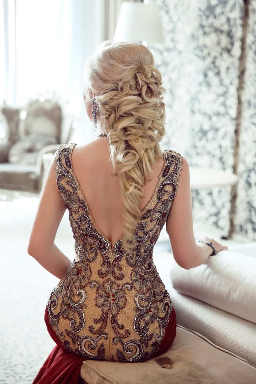 This striking hairstyle for women with long hair features a fluffy ponytail-style braid in Finnish style with lots of twists and turns.