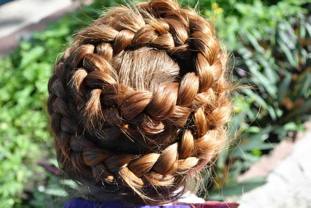 If you want your hairstyle to be unique and intricate, then this is the hairdo just for you. This is the kind of braid that involves French braiding in a circular motion from the crown all the way to the nape of your neck. Have this jaw-dropping hairstyle to perfection by hiring a professional hair stylist for the job.