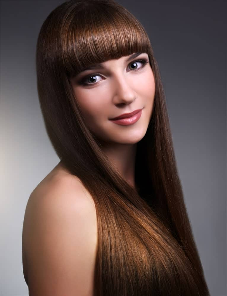 Another hairstyle with fringes, however, this one has very thick straight fringes that end right above the eyebrows, continuing into long, straight hair that gracefully fall over both shoulders.