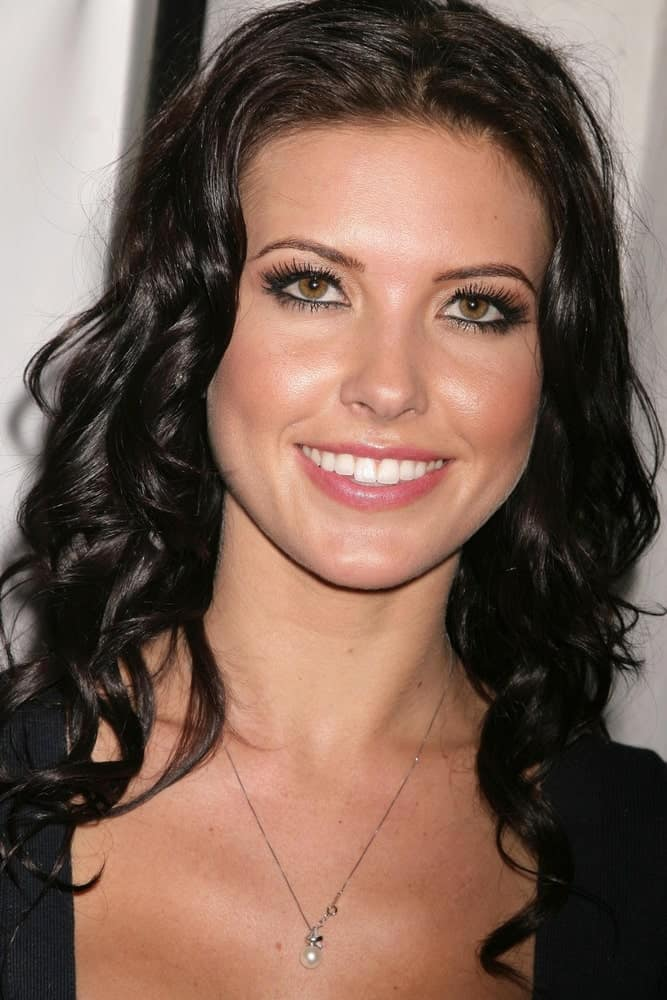 This is Audrina Patridge super tight and small curls from top to bottom and a parting going down the middle of the hair.