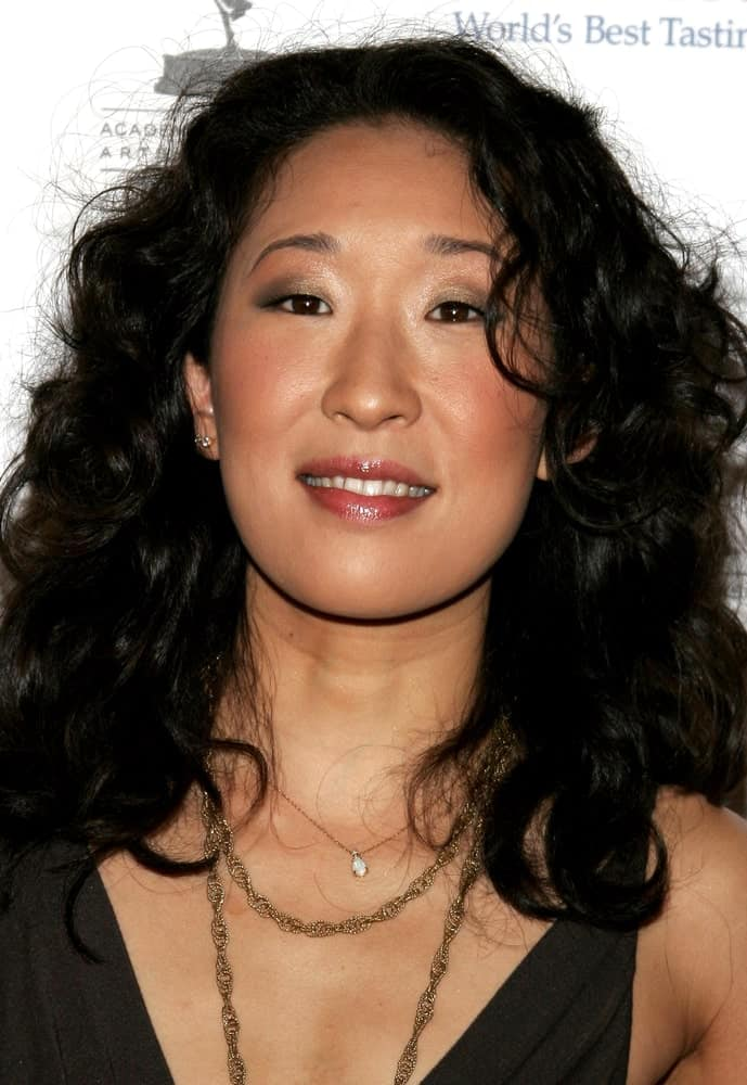 This is the famous Grey's Anatomy star Sandra Oh with slightly messy curls all the way from top to bottom.