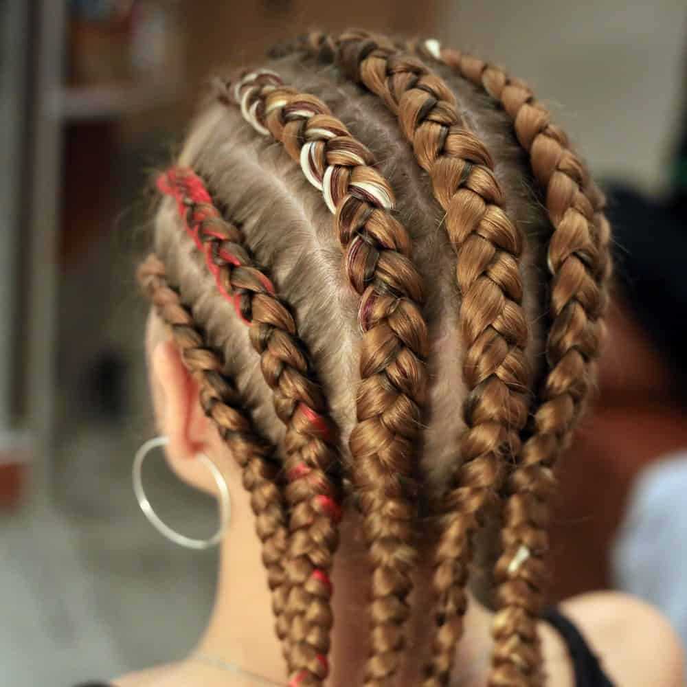 While this type of braided hairstyle originated from traditional African fashion, women all over the world try carrying it because of its cool style. From the side cornrow braid to thick, middle cornrow braids, the options to experiment this hippy hairstyle are plenty.