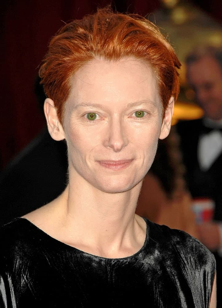 A short bob without the tons of extra short layers can still look edgy and modern like we see here on Tilda Swinton. The swept-back look gives a very high fashion look overall.