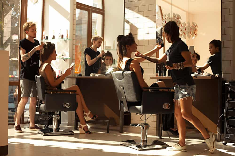 Women getting hair done in hair salon