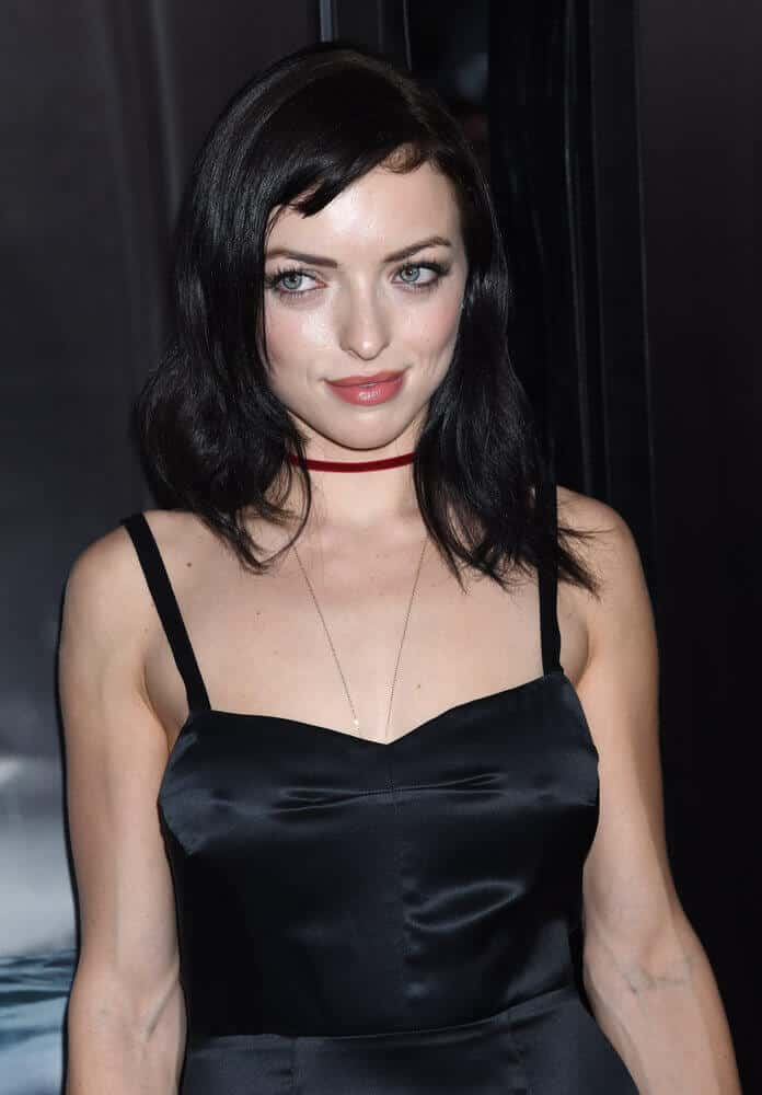 Francesca Eastwood rocking her loose, medium-length hair with super short side bangs for an added detail.