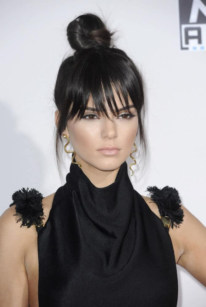 Kendall Jenner slays this cute yet edgy hairstyle during the 2015 American Music Awards. Her extra high bun is paired with wispy bangs to balance out the whole look.