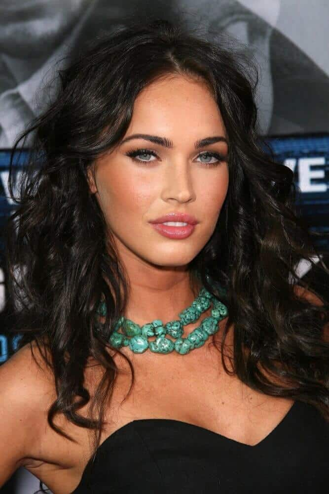 Megan Fox channeling her subtle edginess with this medium-length, wavy hairstyle tousled a little for an extra texture.