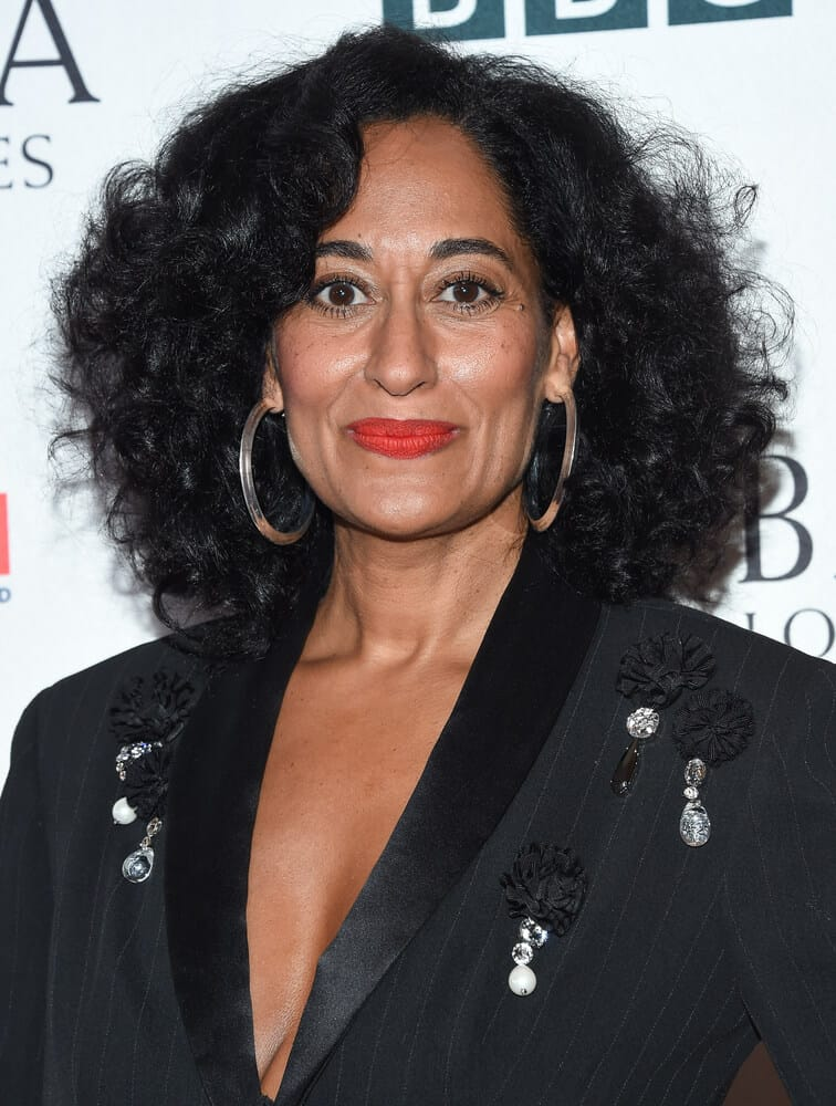 Tracee Ellis Ross looking carefree with her thick curls flaunted beautifully with the help of hair products for easy maintenance.