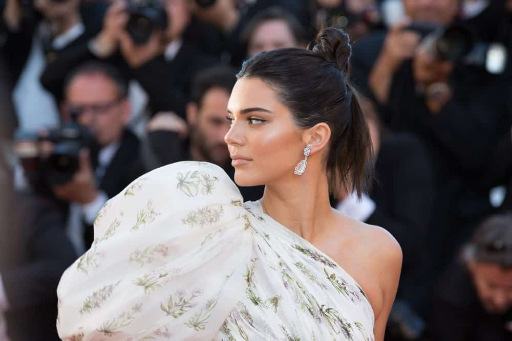 For those who think you can't make elegant buns with short hair, look no further than Kendall Jenner for inspiration. The supermodel took half of her chin-length hair and twisted it up to the top of her hair in an elegant ballerina bun.