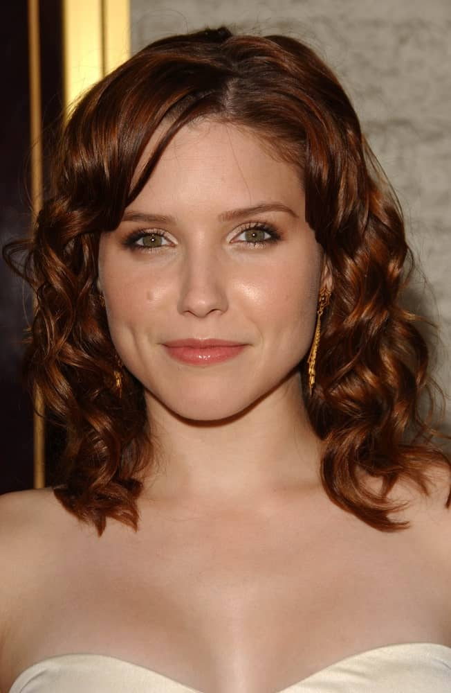 Sophia Bush demonstrates a genius style for women with curly hair. A bob cut that features tousled hair is a decent and sophisticated hairstyle that will look good regardless of the various factors such as your face profile, hair color or even skin tone.