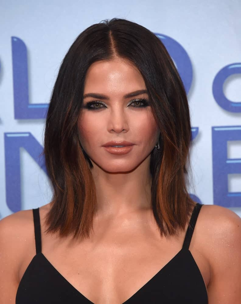 Jenna Dewan blows fans away with this incredible hairstyle that is so simple yet looks amazing. It has a sleek middle parting followed by jet straight hair all over. The front two strands of hair appear to be slightly wavy that add a little volume to the hair.
