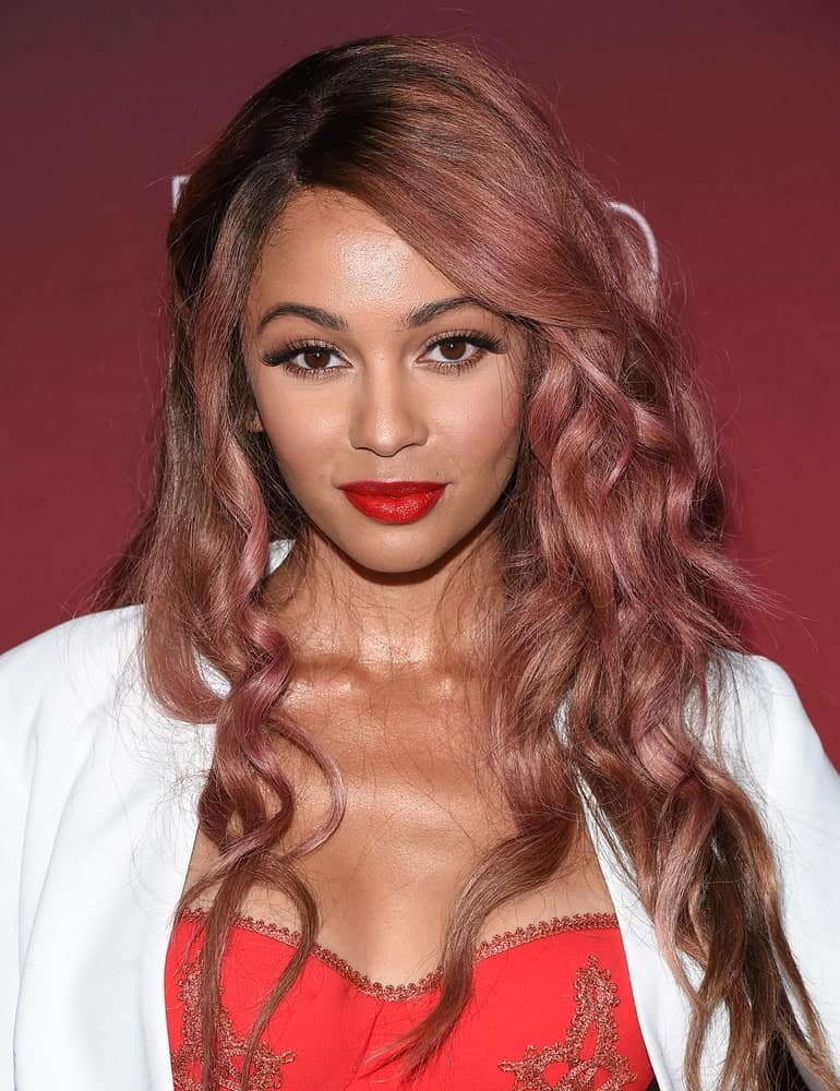 If you are planning to dye your curly hair, then this shade is a good one to consider as it suits almost all skin tones. A blend of faded crimson and ash brown hues will look really fascinating if you have curly hair like Vanessa Morgan.