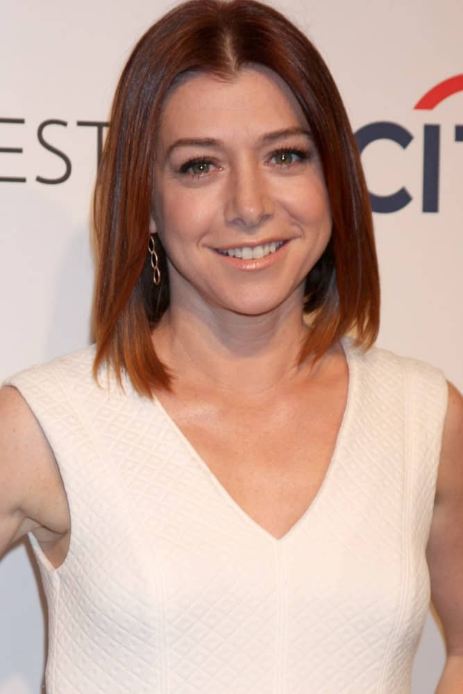Alyson Hannigan perfectly demonstrates how wonderful having red hair can be because a hairstyle as simple as this can look really great. If you want short red hair that doesn't require much styling, then go for a chin-length cut and wear your hair down to look effortlessly stylish.