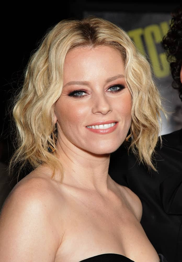 This is Elizabeth Banks looking super chic and fresh in this curled hairdo of hers. This hairstyle is s short bob with a middle parting and stiff waves like curls falling on either side of the face. Simple and beautiful best describe this hairstyle!