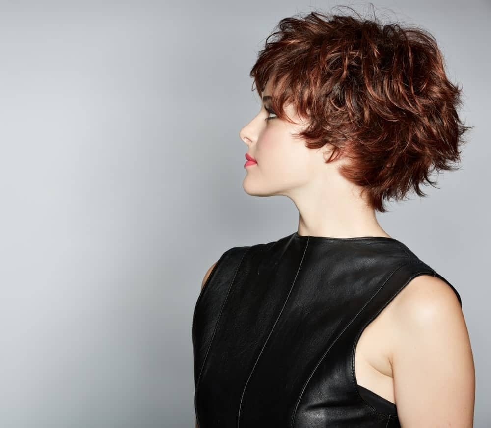 This is a classic, ruffled and messy-looking short hairstyle that looks absolutely chic and funky. Although this one of those hairstyles that are slightly harder to pull off, it is just gorgeous. This hairstyle has layers of short hair that resemble a pixie-cut and the layers seem to have been styled randomly so they graciously fall on top of one another.