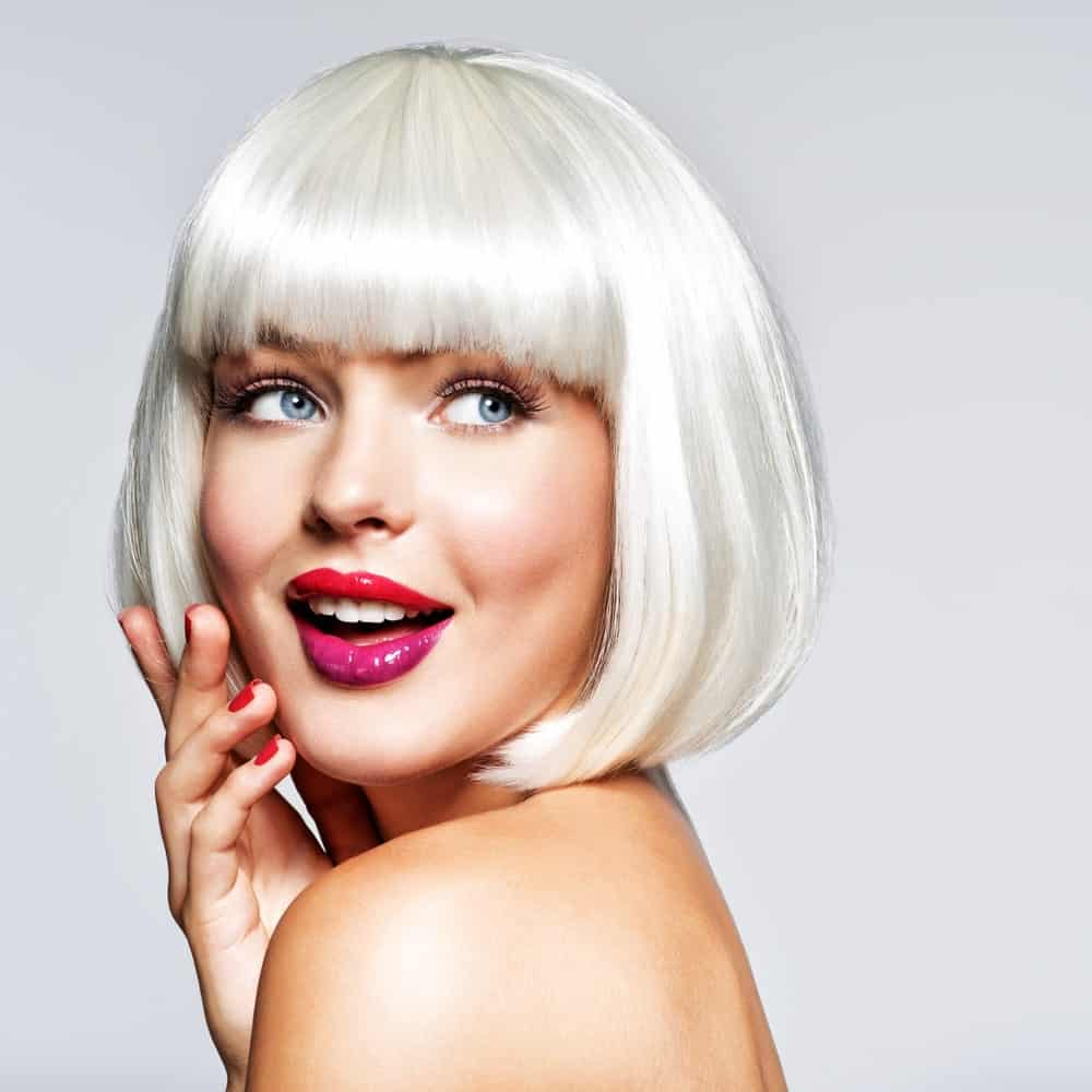 The color silver is one of the most popular trends these days. Complement your classic bob and thick blunt bangs with this icy hue to create an ultra-modern hairstyle. Candy Pink Metallic Balayage
