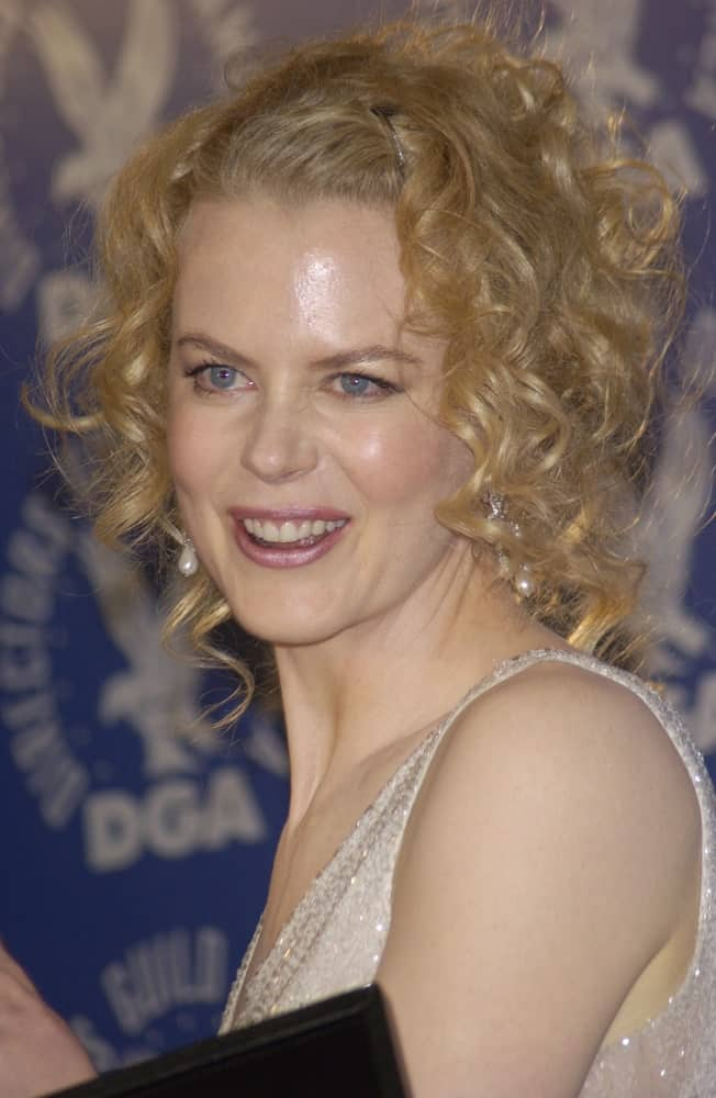 If you ever fancy going bold and big with your hairstyle, perhaps take a leaf out of Nicole Kidman's hair book. This is an amazingly unique and distinctive kind of a curly, short hairdo with extremely tight and small curls that have been pulled up tightly towards the back of the head. A few curly strands of hair are let loose on either side of the face to give the hair some texture and volume.