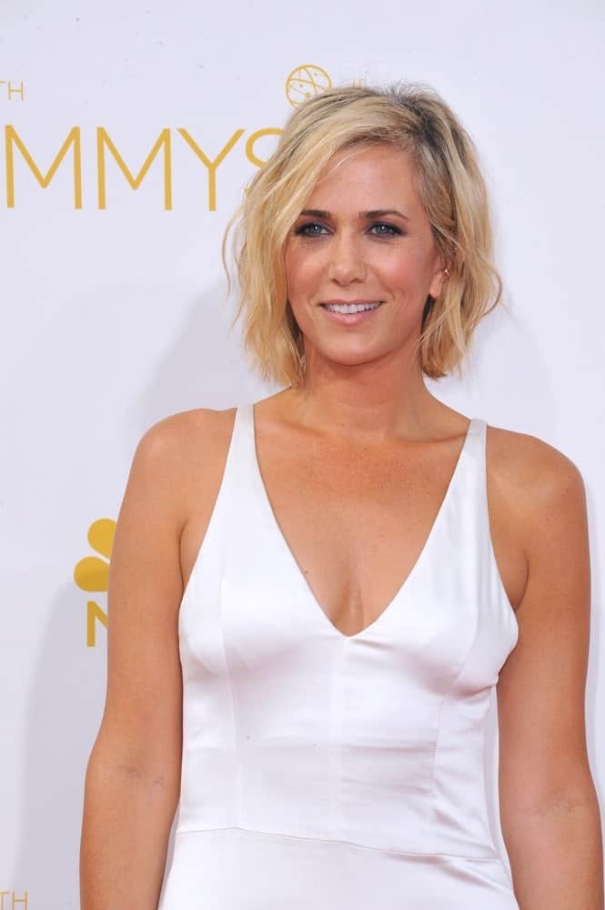 Kristen Wigg's transformation from a brunette to a blonde made her look years younger. The light color looks absolutely great on her and will also on you.