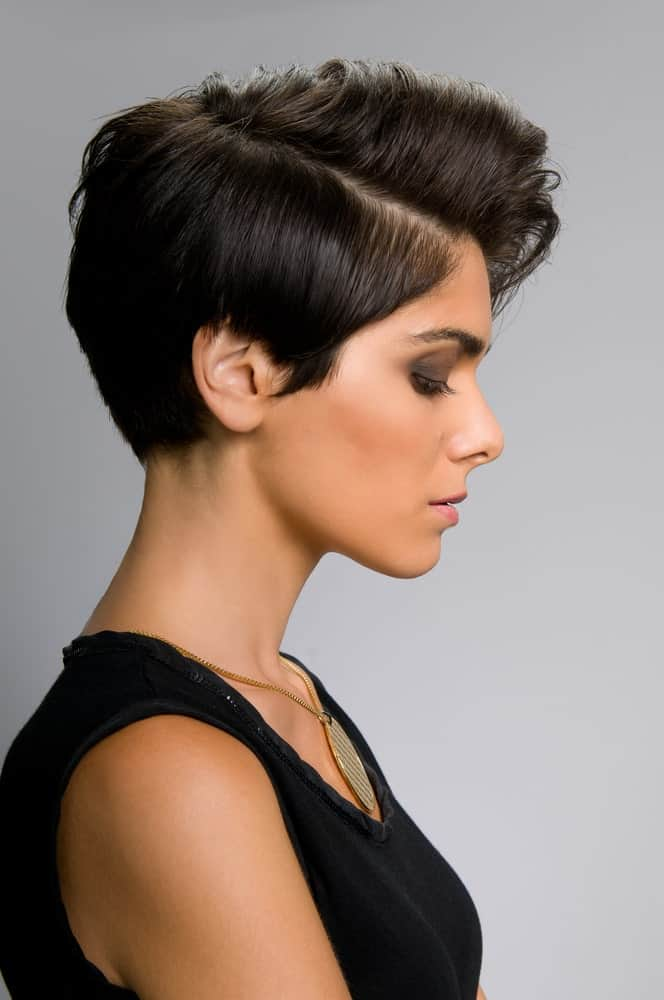 Not everyone fancies going big and bold with their hair but if you are a risk-taker, this hairstyle is for you. It is another classic pixie-inspired cut with a neat side parting. The hair from the top has been poofed a little to give it more volume and texture and the hair at the back has been set in a gelled-back manner to give it a clean, sharp look.