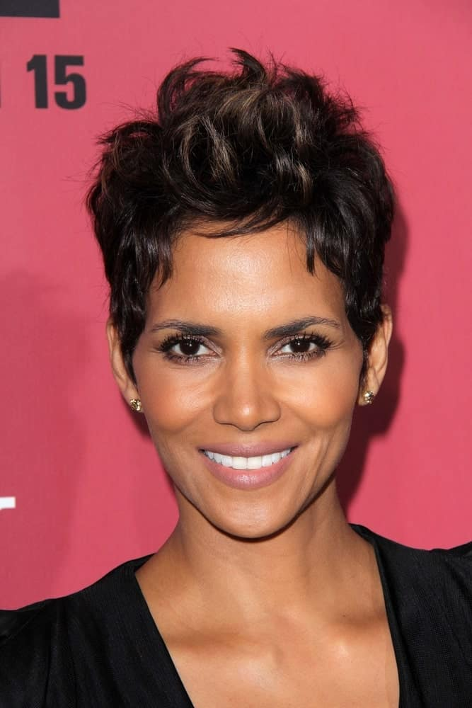 This Mohawk style upward reaching pixie cut is a good style to consider if you want to cut your straight hair really short. For a more fiery and spirited look, dye the tips of the strands with a just a tinge lighter shade like Halle Berry has done here.