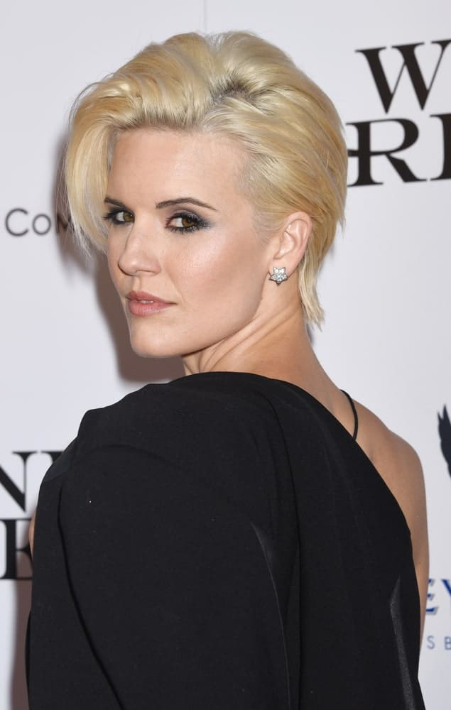 For anyone who loves to go big and bold with their hair, this hairstyle is for them. Maggie Grace looks stunning in her uber-short blonde hairstyle that is quite similar to a pixie-cut but has the hair pulled towards the side, making it look super sleek and slick.