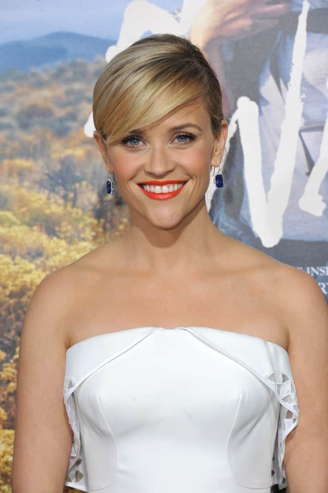 Reese Witherspoon is always a vision in short hair. Here we see her rocking a short straight hairstyle for women in which she has combined a pixie cut and balayage with deep, eye-skimming side-swept bangs. Simple yet stunning, this uncomplicated hairstyle is sure to wow everyone.