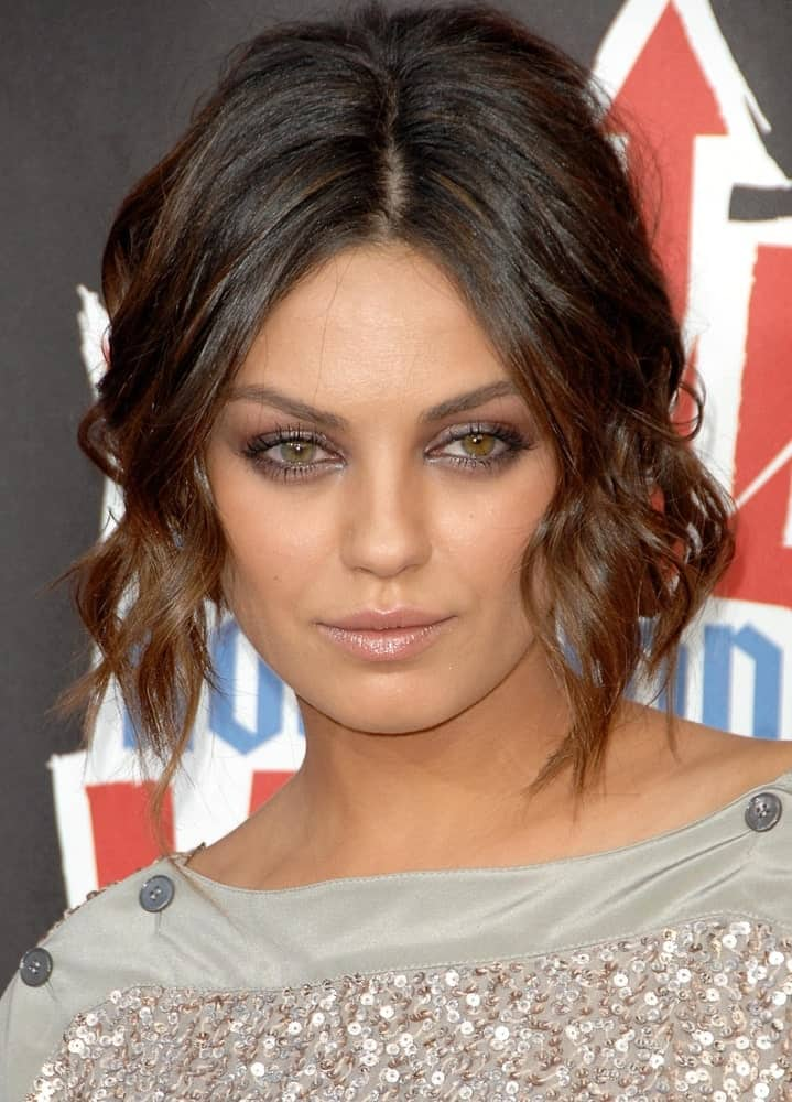 If you love Mila Kunis, then you will also love the hairstyling ideas that she drops every now and then. Rocking a new look quite frequently, the beautiful actress has surely proven the fact that if you go for a bob cut, you will still not run out of ways to style it despite the reduced length. Take notes from this example where we see the Hollywood charmer in a center-parted, deeply angular bob that features wispy, bouncy curls on both sides. Subtle highlights definitely won't hurt either.