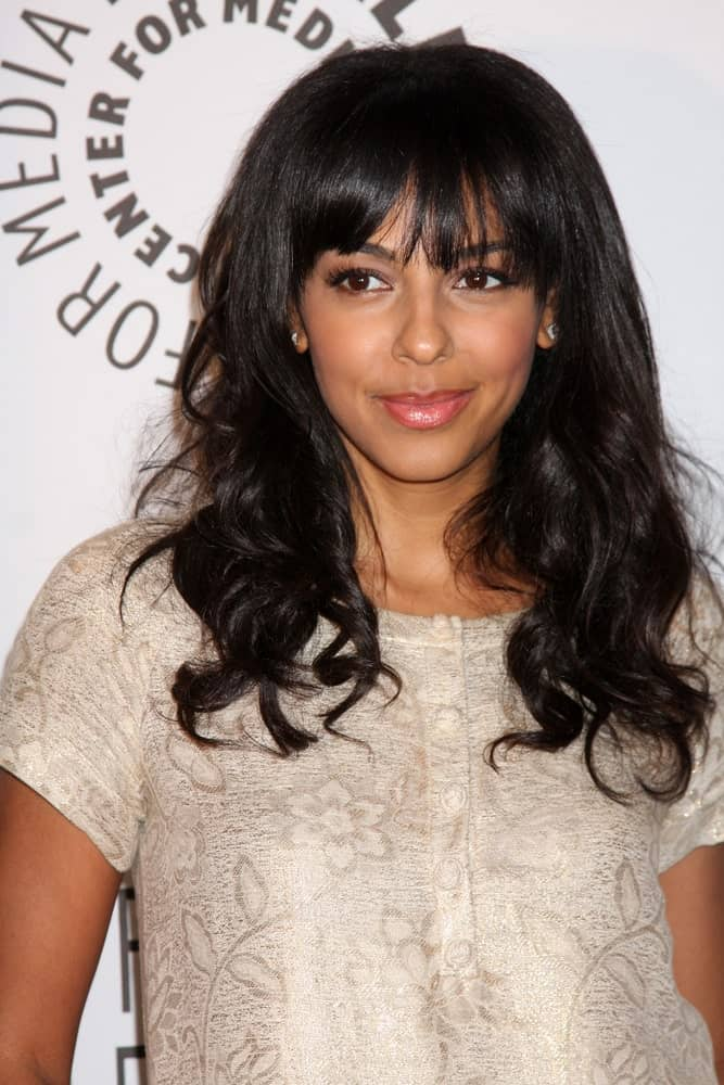 Marsha Thomason shows us how waves look almost near perfect with a nice, soft fringe. Bonus tip: use face framing layers to soften the shape of your jaw with wavy hair.